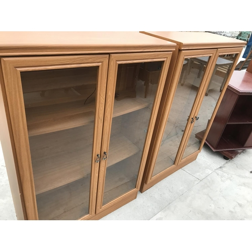 753 - FOUR BOOKCASES - TWO MAHOGANY AND TWO TEAK EFFECT...