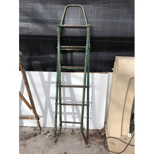 4 - AN INDUSTRIAL SET OF GREEN PAINTED LADDERS TOGETHER WITH FURTHER SIX TIER FOLD OUT STEP LADDER...