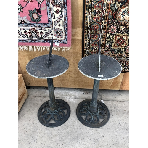 51 - TWO CAST METAL VINTAGE SUN DIALS WITH PIERCED BASES...