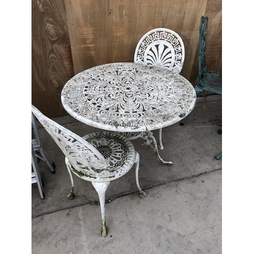 56 - A WHITE PAINTED CAST METAL TWO SEATER GARDEN SET COMPRISING TWO CHAIRS AND CIRCULAR TABLE...
