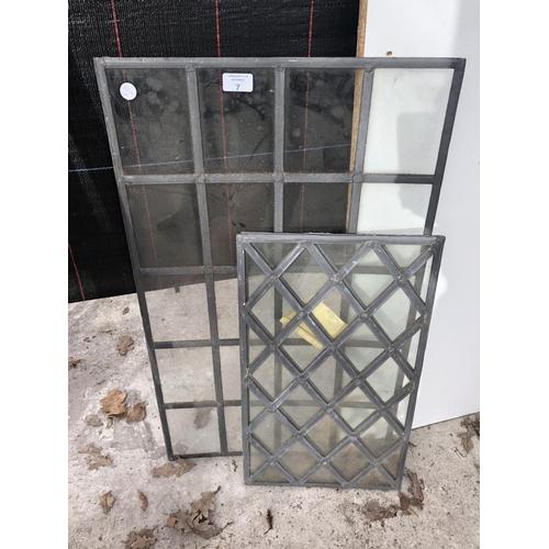 7 - THREE VARIOUS LEAD GLAZED WINDOW PANES...