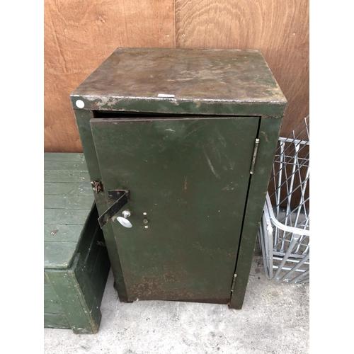 74 - A CAST METAL GREEN PAINTED INDUSTRIAL LOCKABLE SINGLE DOOR CABINET WITH INNER SHELF...