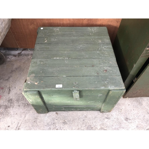 75 - A GREEN PAINTED WOODEN LIDDED BOX WITH ROPE HANDLES...