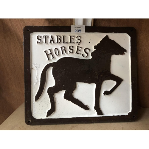 205 - A CAST METAL 'STABLES HORSES' BLACK AND WHITE PAINTED SIGN...
