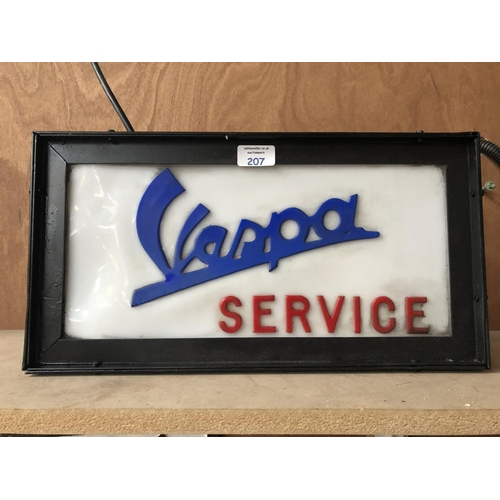 207 - A VINTAGE 'VESPA' SERVICE ILLUMINATED SIGN IN BLACK CASED SURROUND...