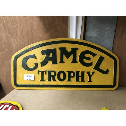 217 - A 'CAMEL TROPHY' YELLOW AND GREEN PAINTED CAST METAL SIGN...