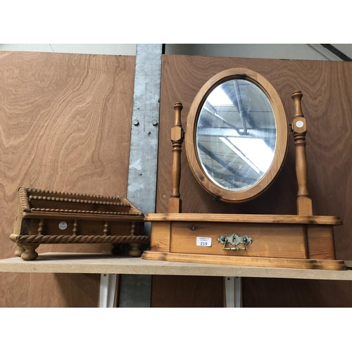219 - A PINE DRESSING TABLE MIRROR WITH OVAL MIRROR AND LOWER DRAWER TOGETHER WITH A FURTHER MAGAZINE RACK...