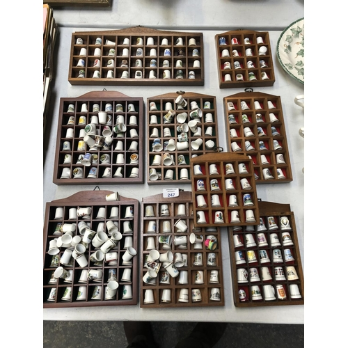 247 - NINE VARIOUS CERAMIC THIMBLE DISPLAY STANDS CONTAINING A LARGE QUANTITY OF THIMBLES FROM VARIOUS MAK...