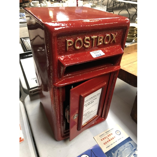 262 - A RED PAINTED CAST METAL POST BOX...
