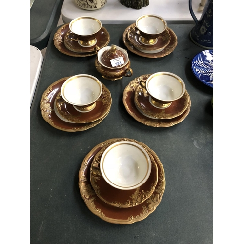 283 - A VICTORIAN STYLE GILT AND IRONSTONE TEA SERVICE COMPRISING FIVE CUPS, SAUCERS AND SIDE PLATES AND A...