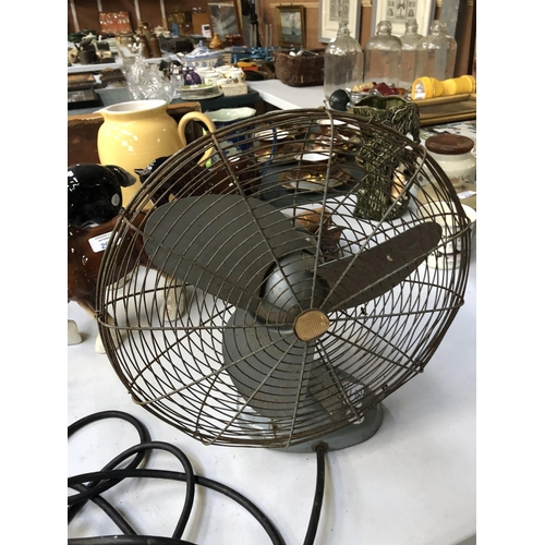 295 - AN INDUSTRIAL STYLE RETRO SWIVEL DESK FAN...