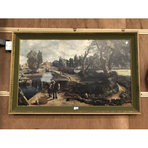 298 - A LARGE GILT FRAMED PRINT OF A LAKESIDE WORKING SCENE 70CM X 110CM...