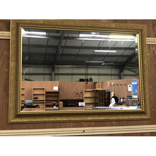 396 - A RECTANGULAR GILT FRAMED WALL MIRROR 88CM X 64CM...