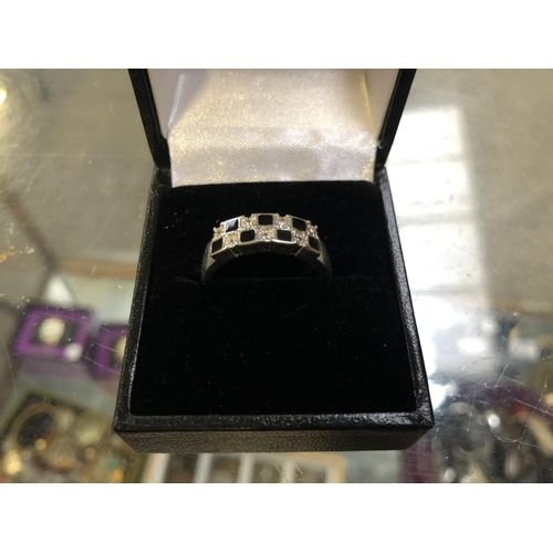 510 - A .925 SILVER STAMPED RING WITH DIAMOND STYLE AND BLACK STONES...