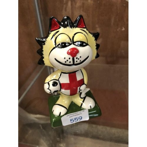 559 - A LORNA BAILEY CERAMIC MODEL OF AN ENGLAND FOOTBALL CAT...