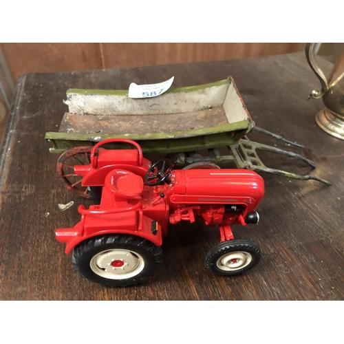 587 - A PORSCHE DIESEL JUNIOR RED TRACTOR WITH VINTAGE CAST METAL TRAILER (2)...