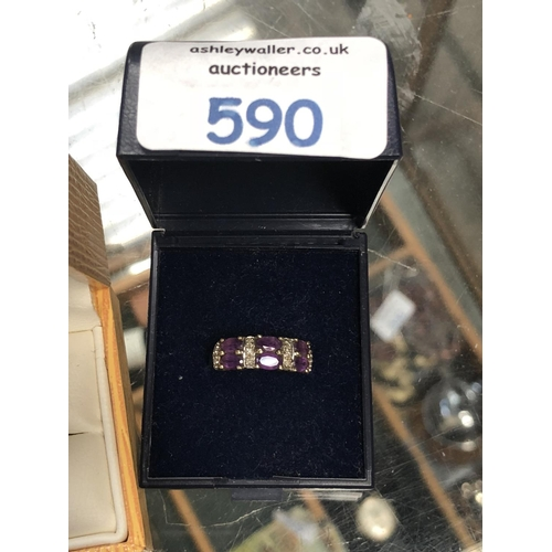590 - A LADIES 9CT YELLOW GOLD RING WITH SIX PURPLE STONES AND CHIP DIAMONDS...