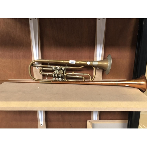 340 - A VINTAGE 'JOSEF GLASSL' BRASS SHORT BUGLE TOGETHER WITH A LONG COPPER HUNTING HORN (2)...