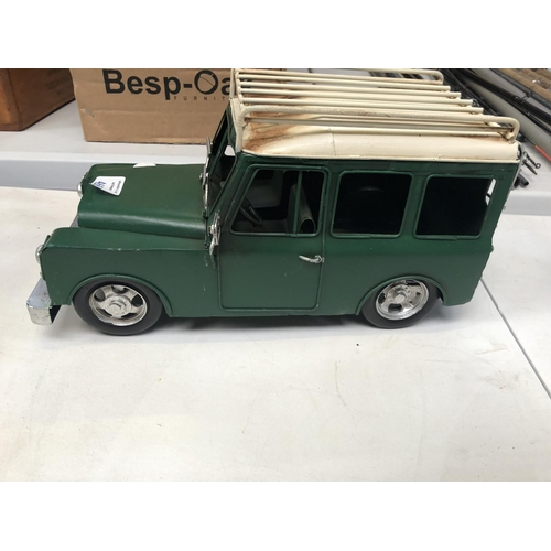 468 - A TIN PLATE GREEN PAINTED MODEL OF A LAND ROVER CAR...