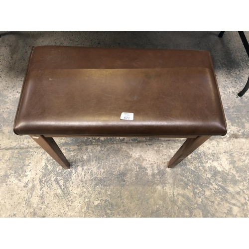 472 - A BROWN LEATHER TOPPED LIDDED FOOTSTOOL...