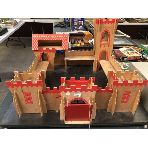 484 - A LARGE WOODEN CHILDREN'S MODEL OF A CASTLE WITH DRAW BRIDGE...