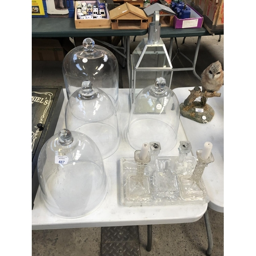 487 - A MIXED GROUP OF GLASSWARE TO INCLUDE FOUR GLASS DOMES, ART DECO STYLE DRESSING TABLE SET ETC (QTY)...