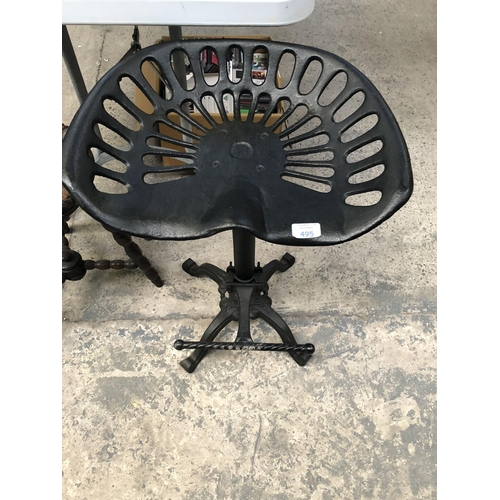 495 - A BLACK PAINTED CAST METAL TRACTORS SEAT / STOOL ON STAND...