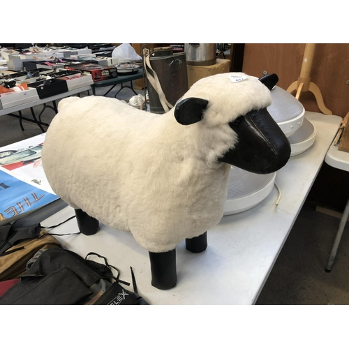 477 - A GOOD QUALITY LEATHER AND WOOL FOOTSTOOL MODELLED AS A SHEEP...