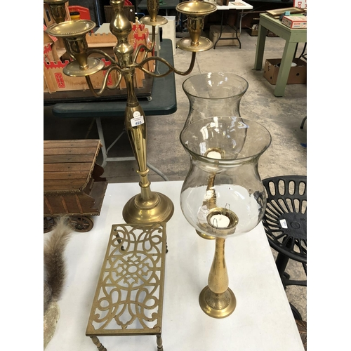493 - A LARGE BRASS FIVE BRANCH CANDLESTICK TOGETHER WITH A PAIR OF BRASS CANDLESTICKS WITH GLASS COVER AN...