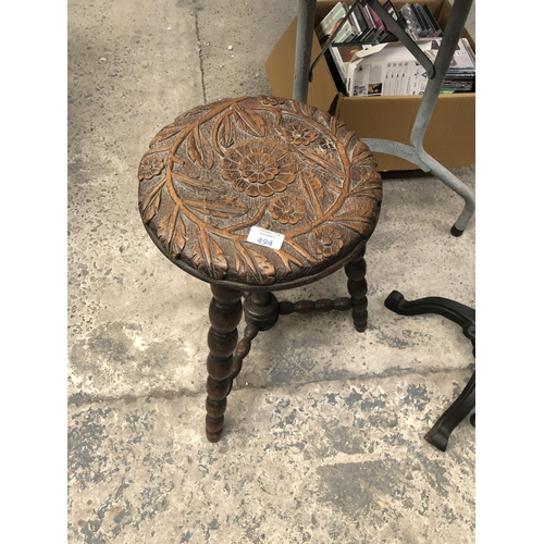 494 - A VICTORIAN OAK CARVED NURSING STOOL WITH BEADED LEGS AND SUPPORTS...