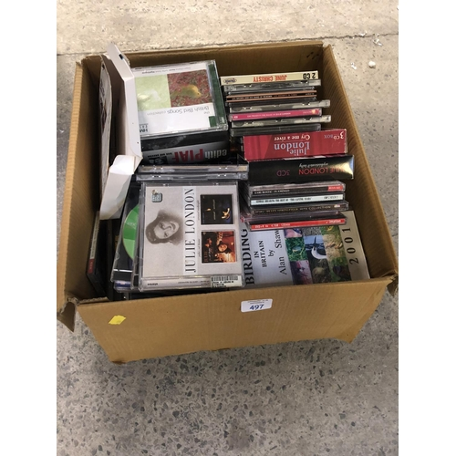 497 - A BOX CONTAINING VARIOUS CD'S AND DVD'S TO INCLUDE JULIE LONDON CD SETS ETC (QTY)...