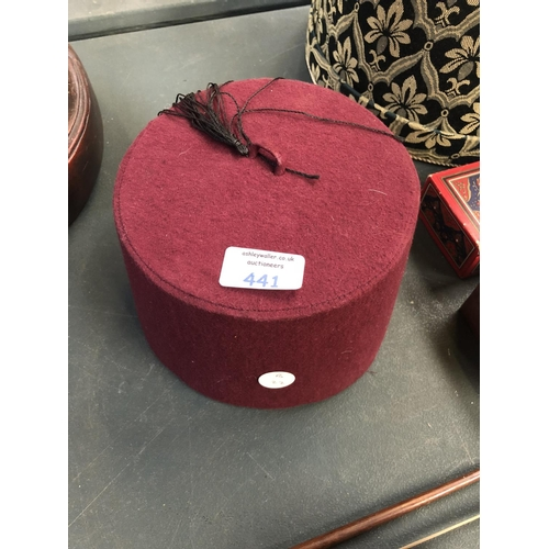 441 - A TURKISH 'FEZ' PURPLE FABRIC HAT (UNBOXED)...
