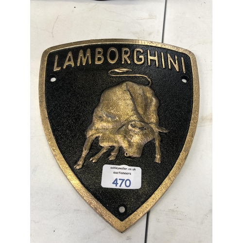 470 - A BLACK AND GOLD PAINTED CAST IRON 'LAMBORGHINI' CAR SIGN...