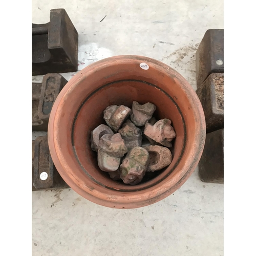 108 - SIX 56 LB WEIGHTS A TERRACOTTA POT CONTAINING TERRACOTTA LION PLANT STANDS AND A MARBLE BLOCK 62 CM ...