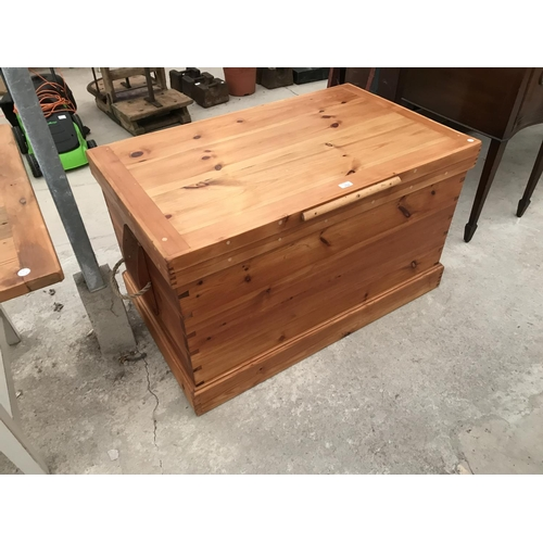 759 - A GOOD QUALITY PINE CHEST WITH ROPE HANDLES 109 CM X 67 CM X 64 CM...