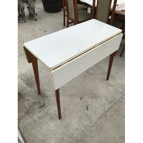764 - A FORMICA DROP LEAF TABLE...