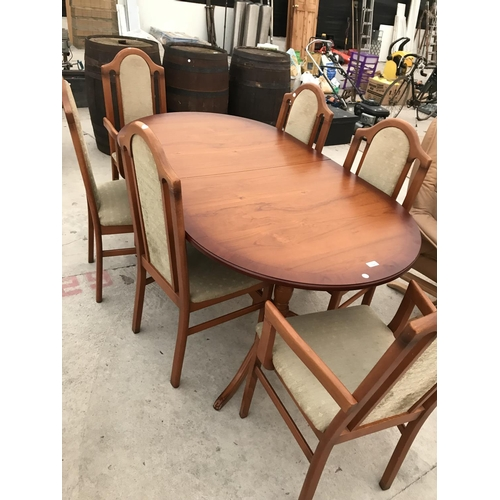 765 - A CHERRY WOOD EXTENDING DINING TABLE WITH FOUR CHAIRS AND TWO CARVERS...