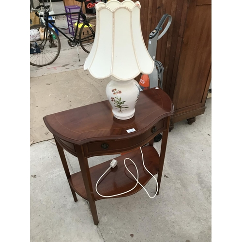768 - A MAHOGANY HALL TABLE AND A CERAMIC TABLE LAMP...