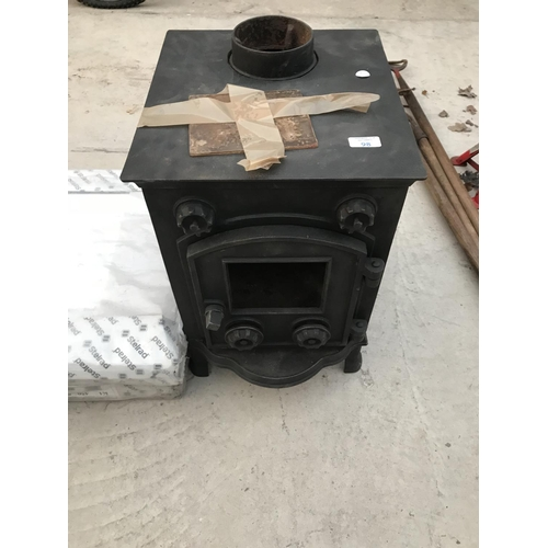 98 - A CAST IRON LOG BURNER WITH SINGLE DOOR (REQUIRES GLASS PANE)...