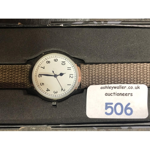 506 - A GENTS BOXED WRIST WATCH WITH BROWN CLOTH STYLE STRAP...