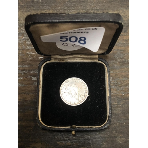 508 - A BOXED SILVER COIN BROOCH...