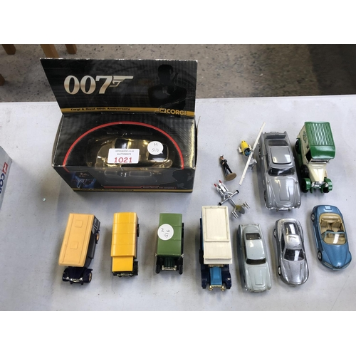 1021 - A MIXED GROUP OF LOOSE COLLECTABLE CAR VEHICLES TO INCLUDE A BOXED 'CORGI ASTON MARTIN V12 VANQUISH ...