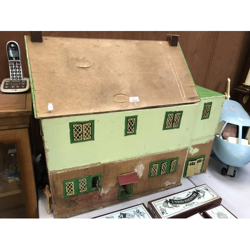 1024 - A LARGE PAINTED WOODEN DOLL'S HOUSE WITH EXTENSION AND SWINGING DOOR...