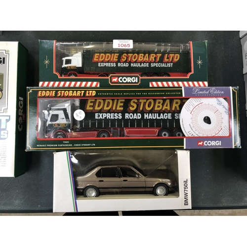 1065 - TWO BOXED 'CORGI EDDIE STOBART' TRUCKS TOGETHER WITH A 'SCHABAK' BMW 750iL BOXED SCALE VEHICLE (3)...