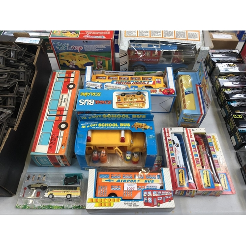 1097 - 11 VARIOUS BOXED ITEMS TO INCLUDE MODEL AIRPORT BUSES, AUTO BUSES, DISNEY SET, ETC (11)...