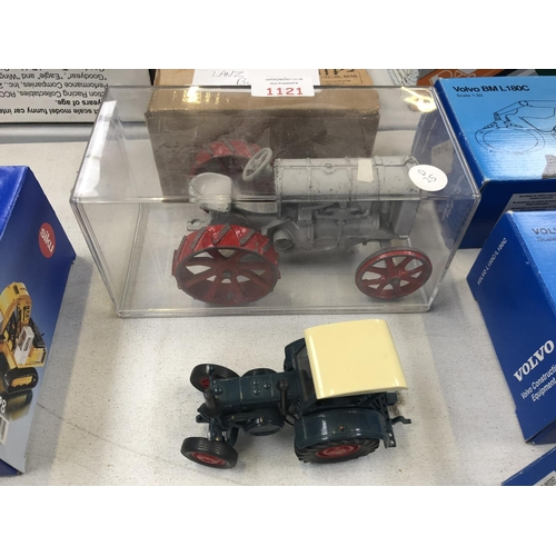 1121 - A VINTAGE METAL MODEL OF A 'FORDSON F' TRACTOR TOGETHER WITH A 'LANZ BULLDOG' MODEL (2)...