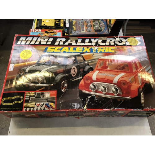 1128 - A 'MINI RALLYCROSS SCALEXTRIC' BOXED MINI RALLY SET...