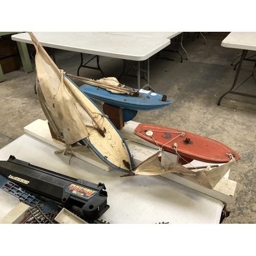 1135 - THREE UN-BOXED WOODEN PAINTED BOAT MODELS ON STANDS (3)...