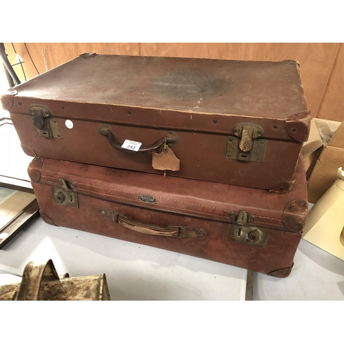 243 - TWO VINTAGE LEATHER TRAVELLING SUIT CASES TO INCLUDE A 'HERCULAX' EXAMPLE, VINTAGE GAMES AND FURTHER...
