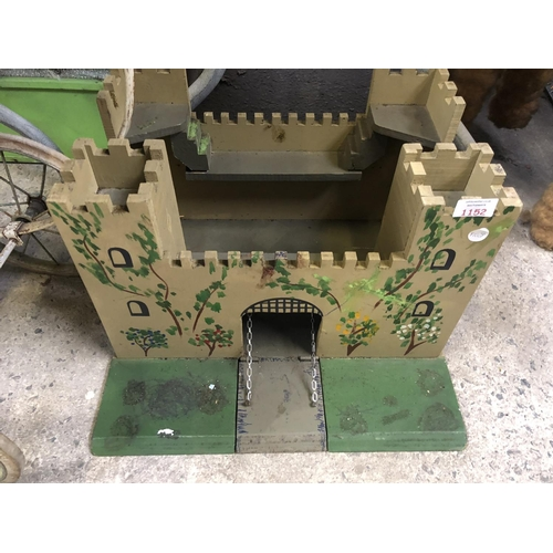 1152 - A CHILD'S WOODEN PAINTED MODEL OF A FORT...